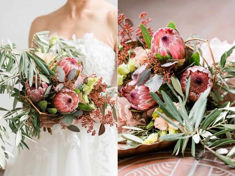 Boho-Brautstrauß mit Zweigen, Blättern und Distelblüten in Rosa.